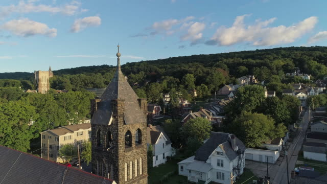 panoramic scenic view of bethlehem, pennsylvania, at sunset. fritz memorial united methodist church. aerial drone video with the panoramic-orbit camera motion. - protestantism stock videos & royalty-free footage