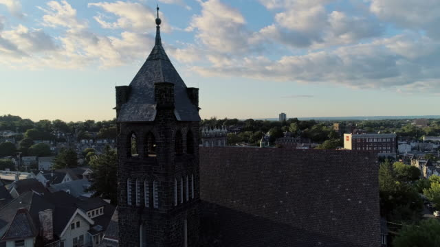 panoramic scenic view of bethlehem, pennsylvania, at sunset. fritz memorial united methodist church. aerial drone video with the orbit camera motion. - protestantism stock videos & royalty-free footage