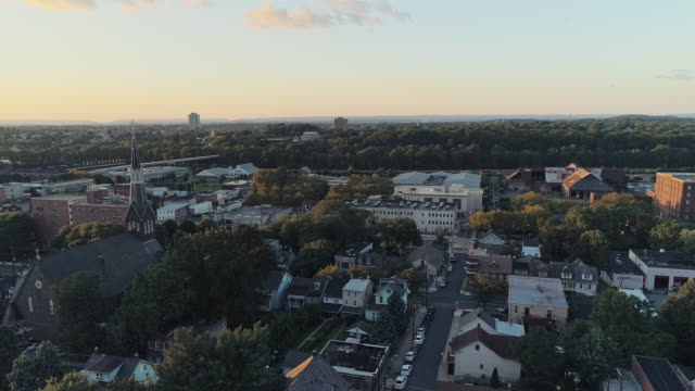 panoramic scenic view of bethlehem, pennsylvania, at sunset. holy infancy catholic church. aerial drone video with the panoramic-backward camera motion. - bethlehem pennsylvania stock videos & royalty-free footage