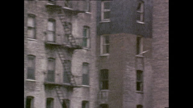 panoramic shot of tenements in the bronx; 1972 - slum stock-videos und b-roll-filmmaterial