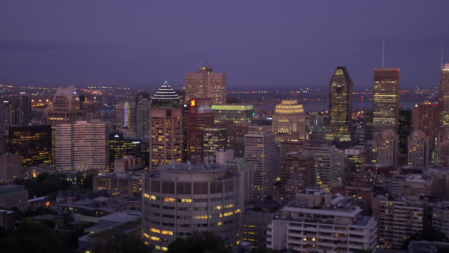 panoramic skyline view of downtown montreal from top view at sunset - panning stock videos & royalty-free footage