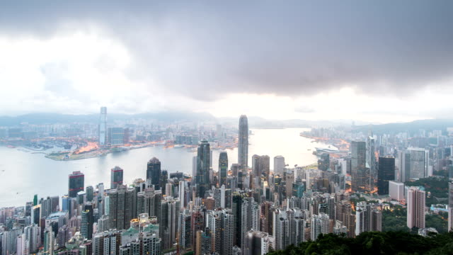 Panoramic skyline,illuminated modern buildings of hong kong night to day.time lapse.