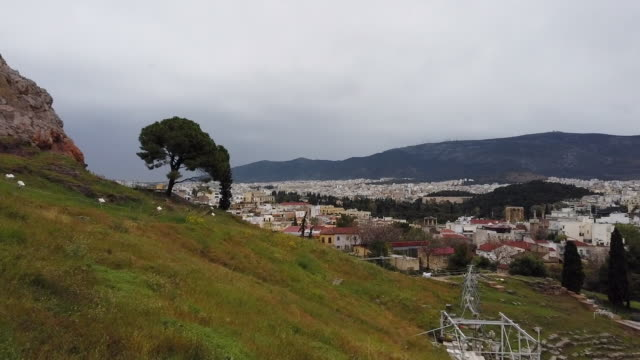 panoramic top view of ancient theatre of dionysus / acropolis and urban skyline of city athen - peloponnes , greece - lycabettus hill stock videos & royalty-free footage