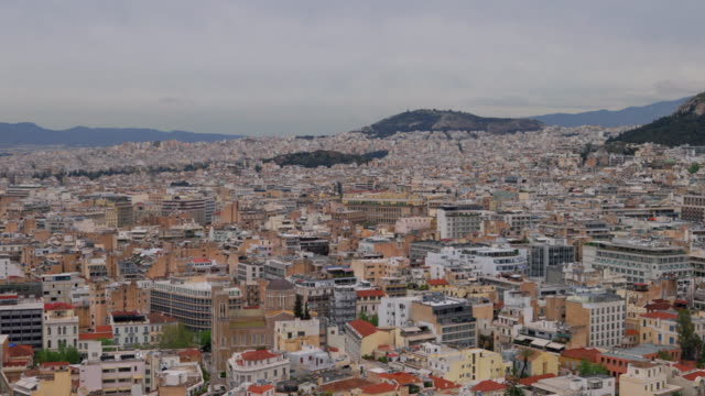 panoramic top view of urban skyline of city athen from the hill of the acropolis - peloponnes , greece - lycabettus hill stock videos & royalty-free footage