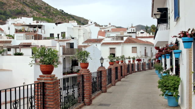 Panoramic view from a typical street to an urban area of Mijas
