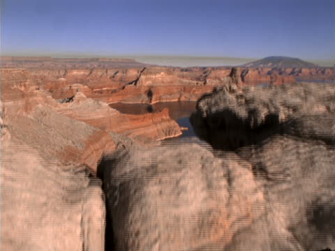 panoramic view of a large reservoir in colorful canyon lands. - named wilderness area stock videos & royalty-free footage