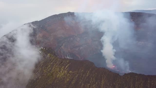 panoramic view of active nyiragongo volcano with lava lake emitting smoke - shack stock videos & royalty-free footage