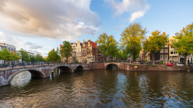 panoramic view of canal houses with clouds in amsterdam - 4k time-lapse - amsterdam stock videos & royalty-free footage