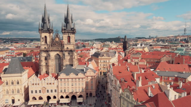 panoramic view of church of our lady before týn in old town hall tower in prague - prague old town square stock videos & royalty-free footage