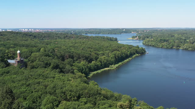 panoramic view of dense forest with lake / berlin, germany - wide stock-videos und b-roll-filmmaterial