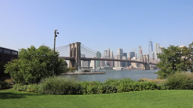 panoramic view of downtown manhattan and brooklyn bridge / new york city, new york state, united states - suspension bridge stock videos & royalty-free footage