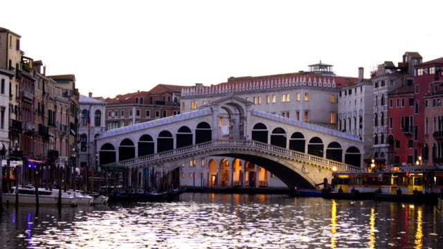 panoramic view of famous canal grande from famous rialto bridge at sunset in venice - grande stock videos and b-roll footage