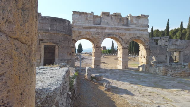panoramic view of frontinus gate in ancient ruins in hierapolis agora, pamukkale - arch stock videos & royalty-free footage