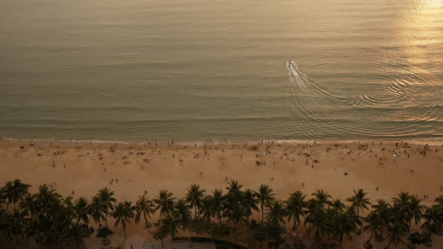 panoramic view of hai yue guang chang beach at dusk in sanya, hainan province, china. view from above. - spoonfilm stock-videos und b-roll-filmmaterial