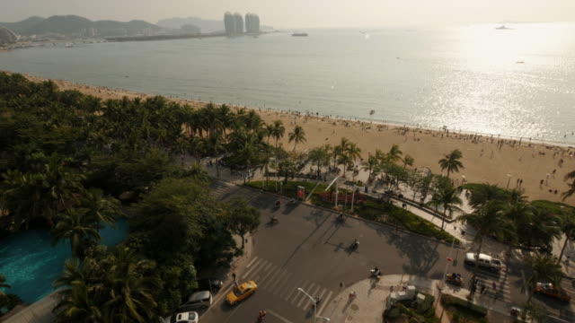 panoramic view of hai yue guang chang beach in sanya, hainan province, china. wide shot from above. phoenix island in background - spoonfilm stock-videos und b-roll-filmmaterial