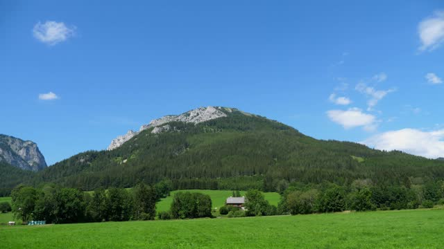 panoramic view of idyllic mountain scenery in the alps with fresh green meadows in bloom on a beautiful sunny day in springtime - traditionally austrian stock videos & royalty-free footage