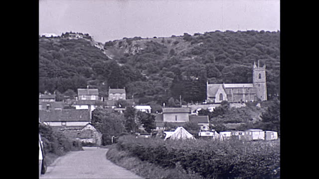 panoramic view of kewstoke church and caravan site. archival from 1940s - 1940 1949 stock-videos und b-roll-filmmaterial