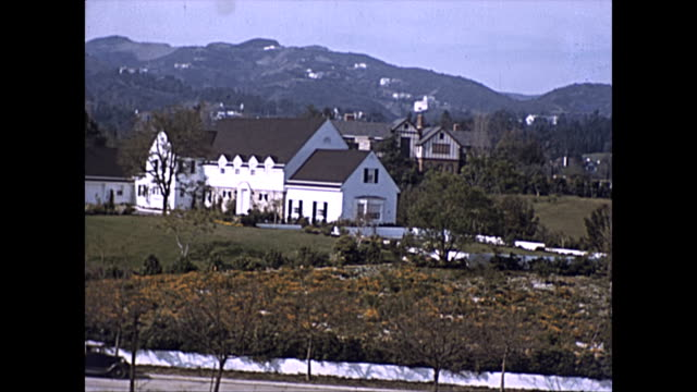 stockvideo's en b-roll-footage met panoramic view of luxury homes in the beverly hills area 1939 - beverly hills californië