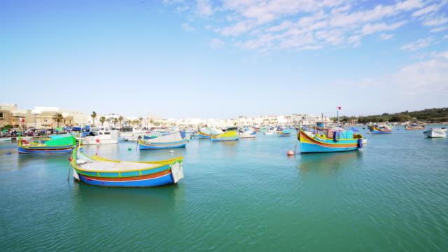 panoramic view of marsaxlokk open fish market bazaar in malta - mediterranean culture stock videos & royalty-free footage