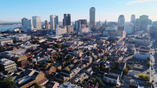 panoramic view of new orleans downtown financial district over the french quarter at evening.  aerial drone video with the backward camera motion. - new orleans stock videos & royalty-free footage