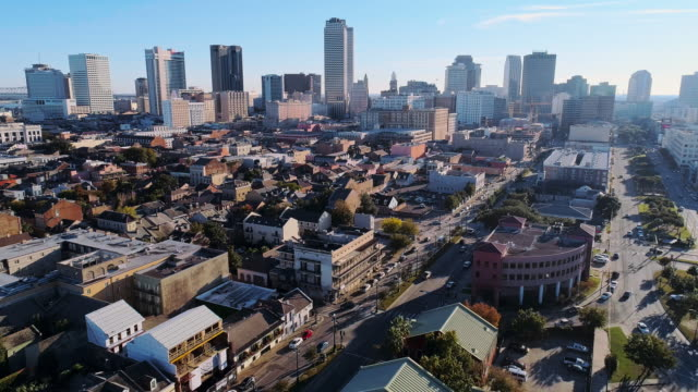 panoramic view of new orleans downtown financial district over the french quarter at evening.  aerial drone video with the backward and panoramic camera motion. - new orleans stock videos & royalty-free footage