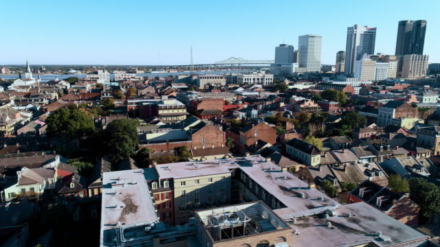 panoramic view of new orleans downtown financial district over the french quarter at evening.  aerial drone video with the panoramic camera motion. - new orleans stock videos & royalty-free footage