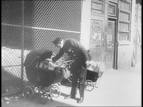 panoramic view of new york city / pedestrians and cars move about near an elevated train track in the city / cars pass in front of the façade of the... - pushchair stock videos and b-roll footage
