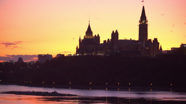 panoramic view of ottawa river and parliament of canada - ottawa stock videos & royalty-free footage