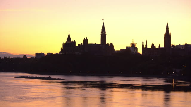 panoramic view of ottawa river and parliament of canada - canadian politics stock videos & royalty-free footage