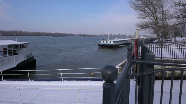 panoramic view of ships, platforms and barges anchored on danube riverbank in wintertime - pavel gospodinov stock videos & royalty-free footage
