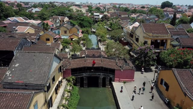 panoramic view of the bridge pagoda from above in hoi an city - traditionally vietnamese stock videos & royalty-free footage