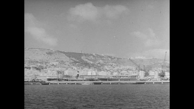 montage a panoramic view of the harbor at haifa and the british battleships docked there / haifa, israel - haifa video stock e b–roll