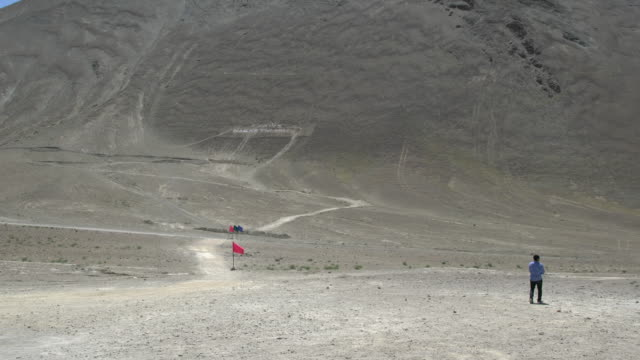panoramic view of the magnetic hill in the himalayas, not far from leh, ladakh - hill stock videos & royalty-free footage