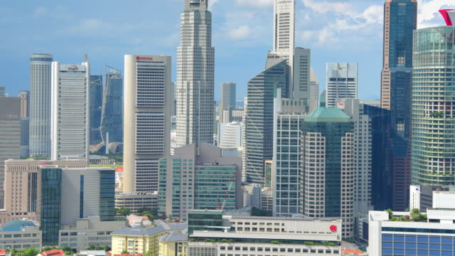 panoramic  view of the singapore skyline and marina bay - singapore flyer stock videos and b-roll footage