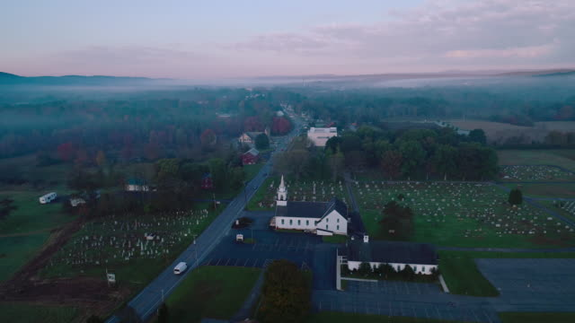 panoramic view of the small town brodheadsville in the appalachian mountains in poconos region, monroe county, pennsylvania. aerial drone video with the panoramic camera motion. - protestantism stock videos & royalty-free footage