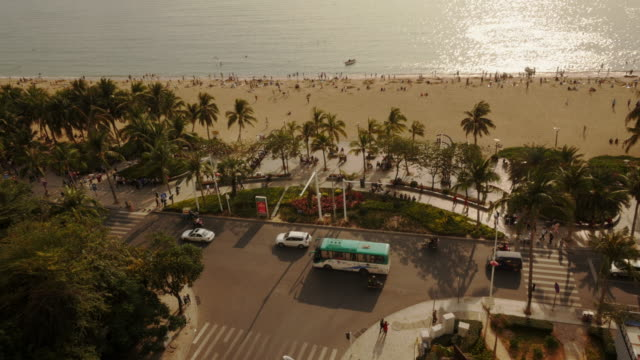 panoramic view of traffic and beach in sanya, hainan province, china. view from above. - spoonfilm stock-videos und b-roll-filmmaterial