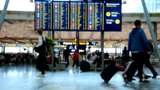 panoramic view of traveler crowd at airport check in counter hall - airplane stock videos & royalty-free footage