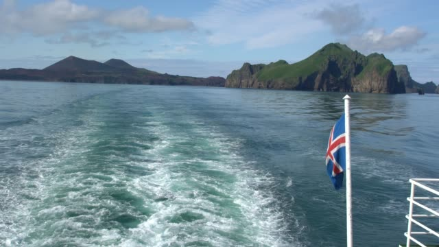 panoramic view of vestmannaeyjar (western islands) seen from the ferry, iceland; iceland flag is visible - 1963 stock videos & royalty-free footage