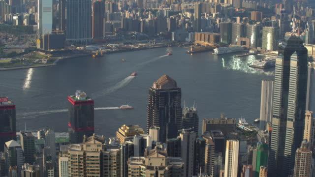 stockvideo's en b-roll-footage met panoramisch uitzicht op victoria harbor en de skyline van hong kong in china bij zonsondergang - hong kong