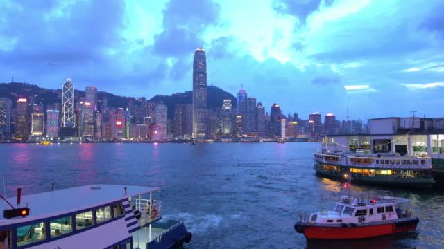 panoramic view of victoria harbor and hong kong skyline in china - victoria hong kong stock videos & royalty-free footage