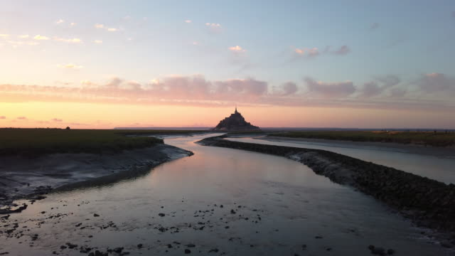 panoramic view of world famous le mont saint-michel tidal island in beautiful post sunset twilight during blue hour at dusk in summer, normandy, northern france - gothic style stock videos & royalty-free footage