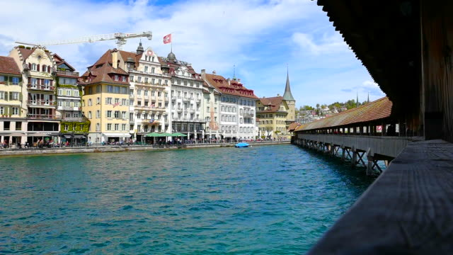 panoramic view over city of lucerne with chapel bridge (kapellbrücke) and the reuss river - lake lucerne stock videos & royalty-free footage