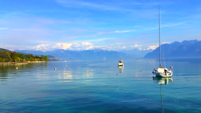panoramic view over lake geneva with mountain - stationary stock videos & royalty-free footage