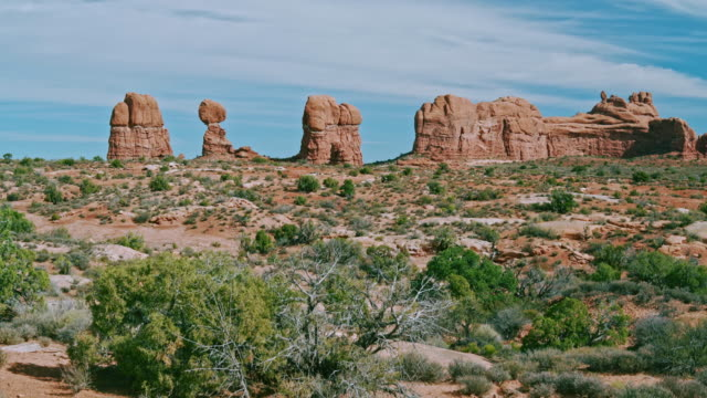 panoramic view to the balancing rock, arches national park, utah - moab utah stock videos & royalty-free footage
