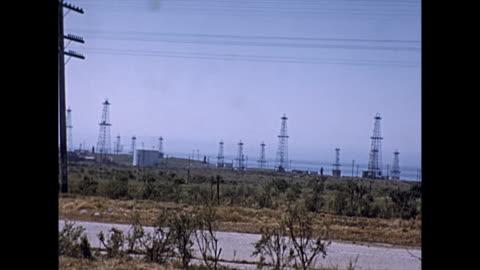 panoramic views of oil dereks in california 1930s - 1930 1939 stock videos & royalty-free footage