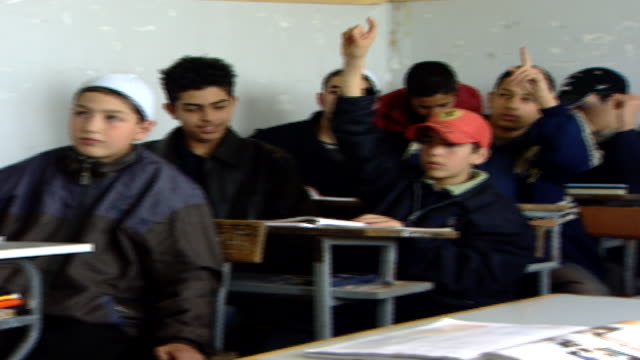 pan-right across a classroom of schoolboys at irfan, a druze religious school with five branches across lebanon that operate as ngos. - theology stock videos & royalty-free footage