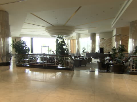 panright across the lobby and the restaurant in the intercontinental hotel - intercontinental hotels group stock videos & royalty-free footage