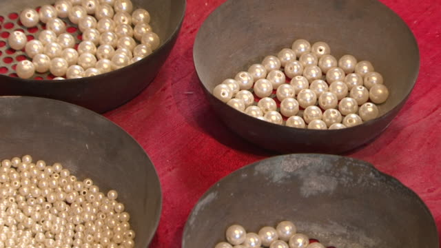 cu panright from bowls filled with pearls to a persian carpet at the heritage house the museum dioramas show life in dubai before the discovery of oil - dish dash stock videos & royalty-free footage