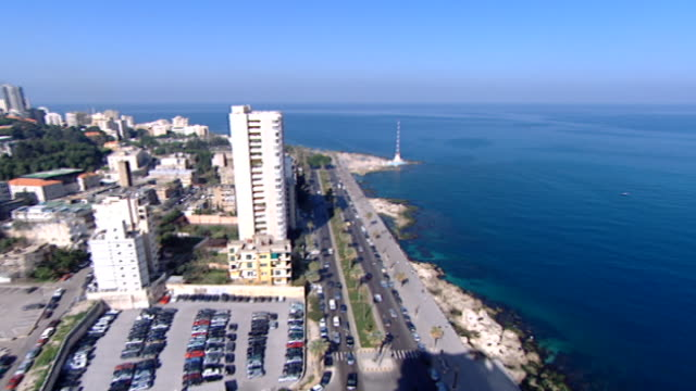 pan-right from the tip of the ras beirut peninsula seaside road, known as the corniche , to a wide view of the mediterranean sea under clear blue... - peninsula stock videos & royalty-free footage