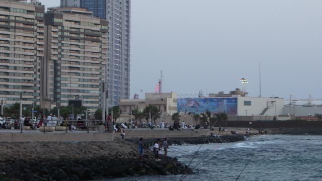 panright of fishermen on jeddah corniche - red sea stock videos & royalty-free footage